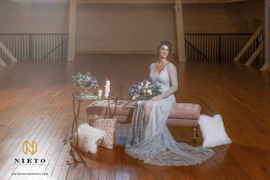 bride smiling as she is sitting on a couch inside of the Wakefield barn