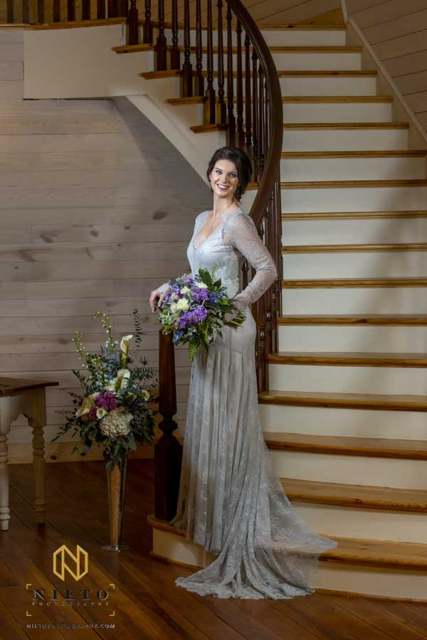 bride smiling as she stands on the stairs of the Wakefield Barn