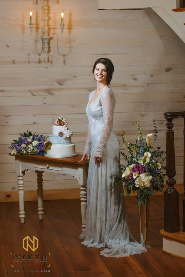 bride standing beside the cake table at the Historic Wakefield Barn
