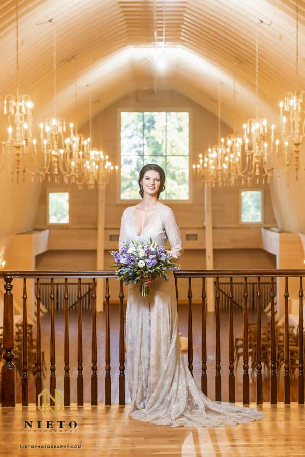 bride posing for a Wakefield Barn Bridal Portraits with flowers in her hands