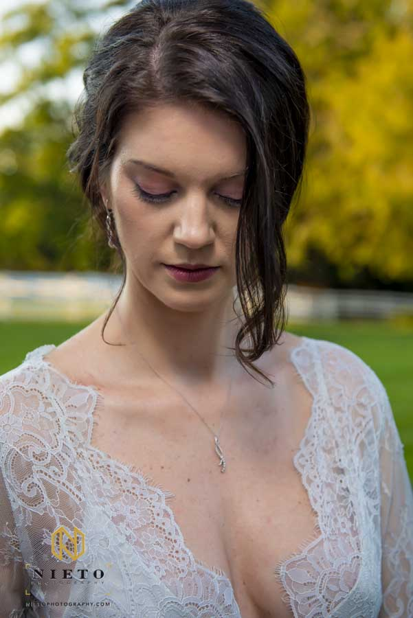 bride closing her eyes to show her purple makeup