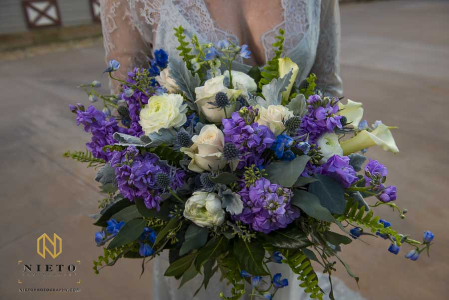 close up image of the bridal bouquet with the bride holding them