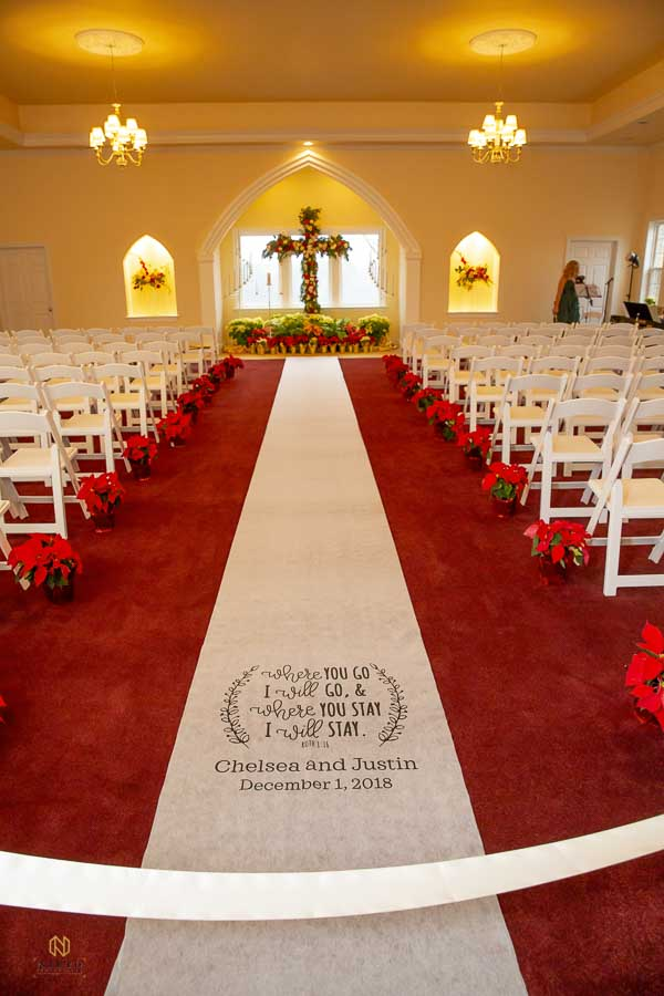 Runner down the aisle in the Chapel at the Hudson Manor