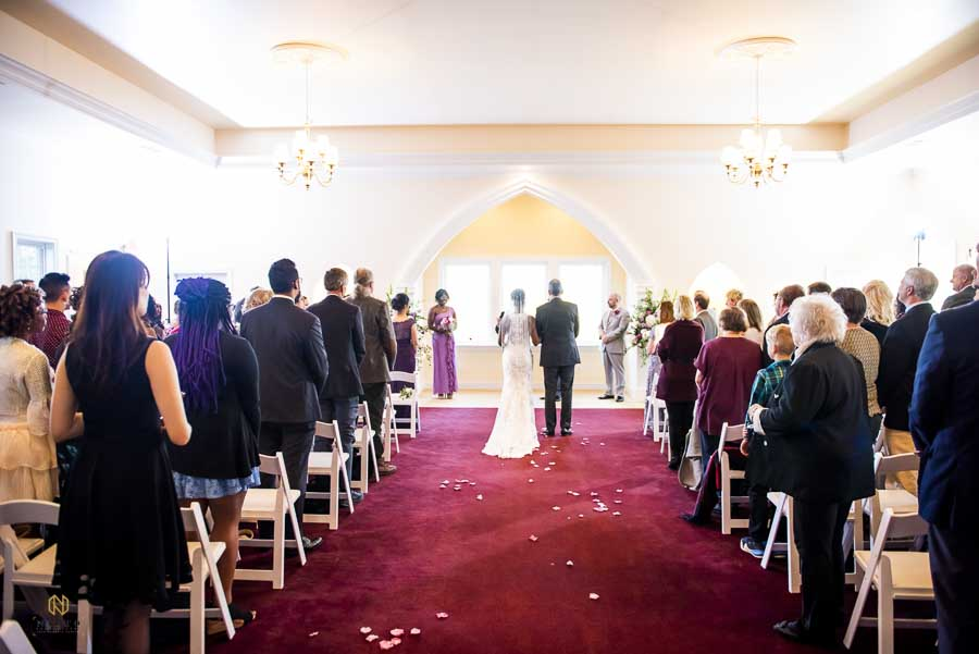 bride and her father walking down the aisle at the Hudson Manor chapel
