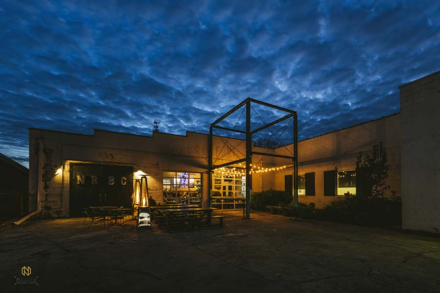 Night shot of Neuse River Brewing Company on a cloudy night