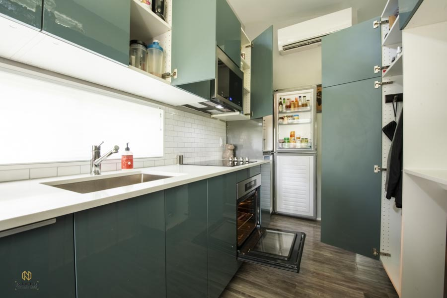 tiny house kitchen with cabinets, refrigerator, and stove open