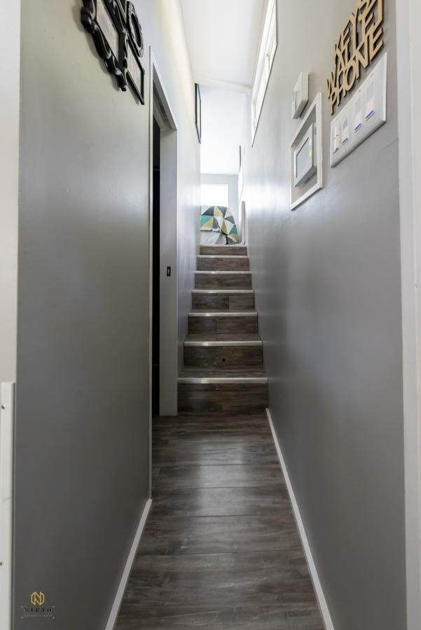 hallway with stairs leading to the master bedroom in a Raleigh tiny home