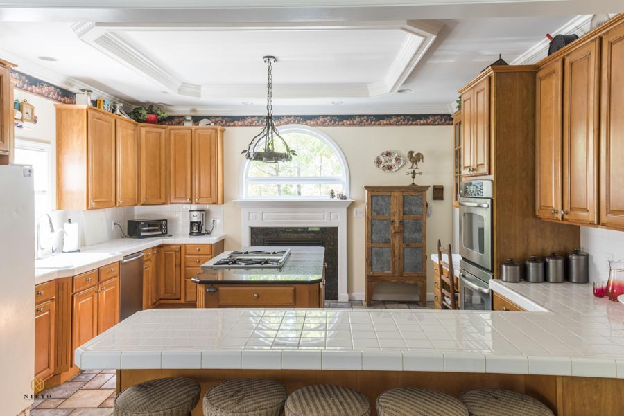 Raleigh real estate image of a white and wood kitchen