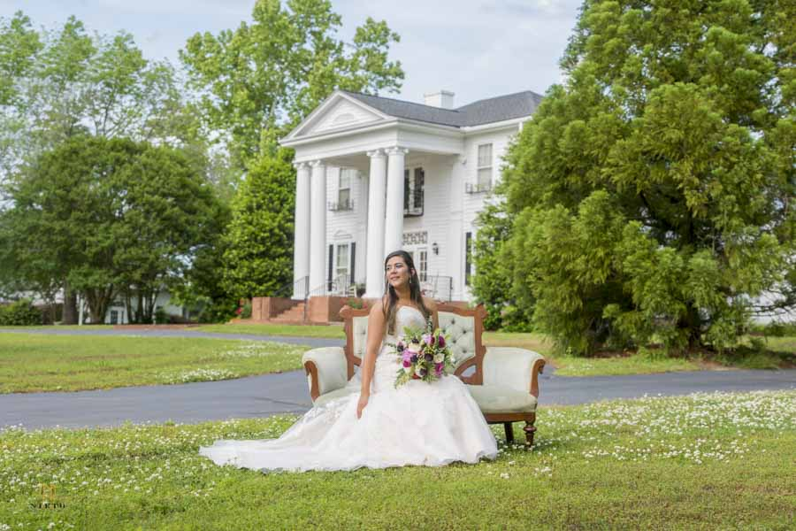 bride sitting and posing for her bridal portrait at the Hudson Manor