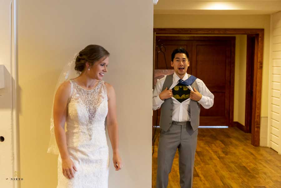 groom showing his batman shirt during his first look with his bride at their Winmock wedding