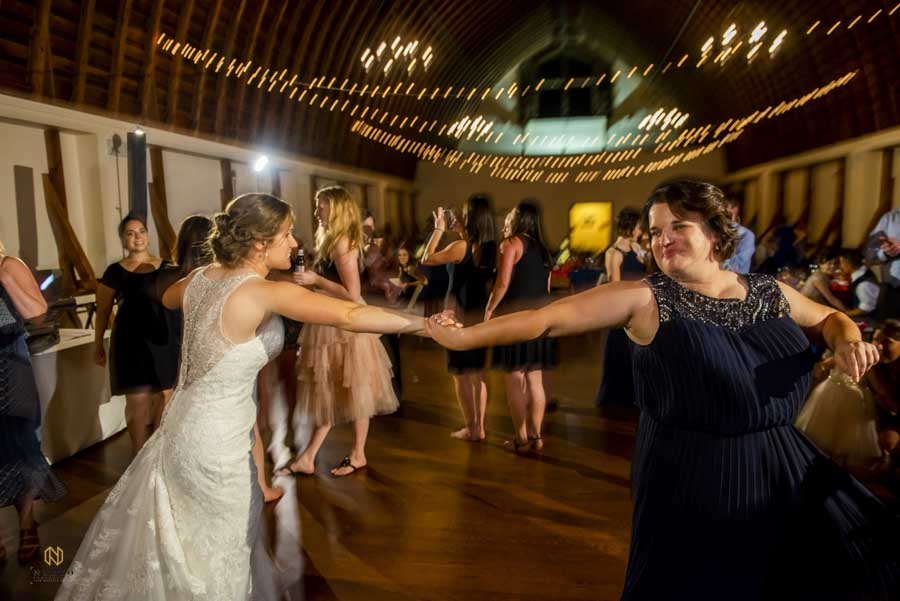 bride and her sister dancing during a wedding reception at Winmock