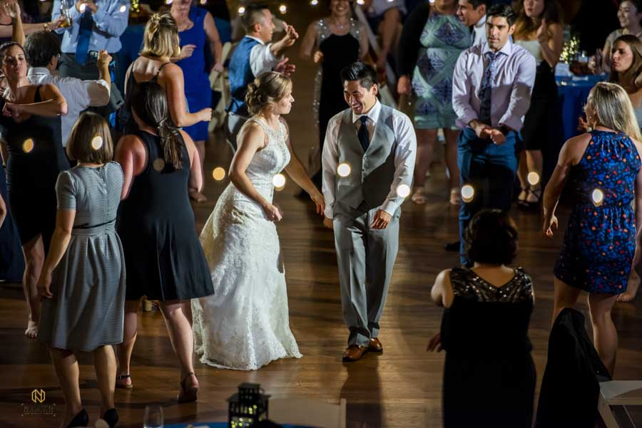 bride and groom dancing with their guest around them at their Winmock barn wedding
