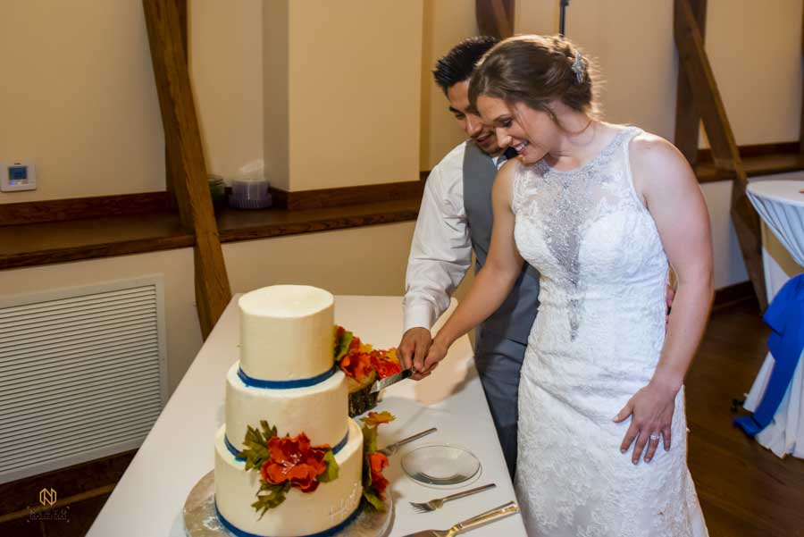 bride and groom cutting their wedding cake at Winmock