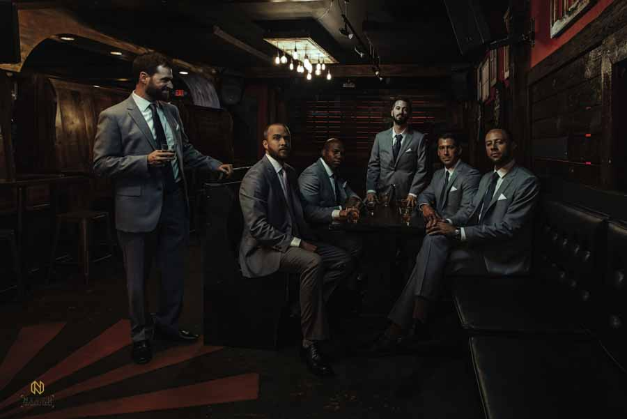groom and his groomsman sitting around Issac Hunters tavern in downtown Raleigh