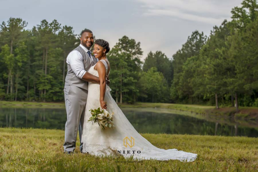 raleigh wedding photography portrait of a couple out doors by a pond