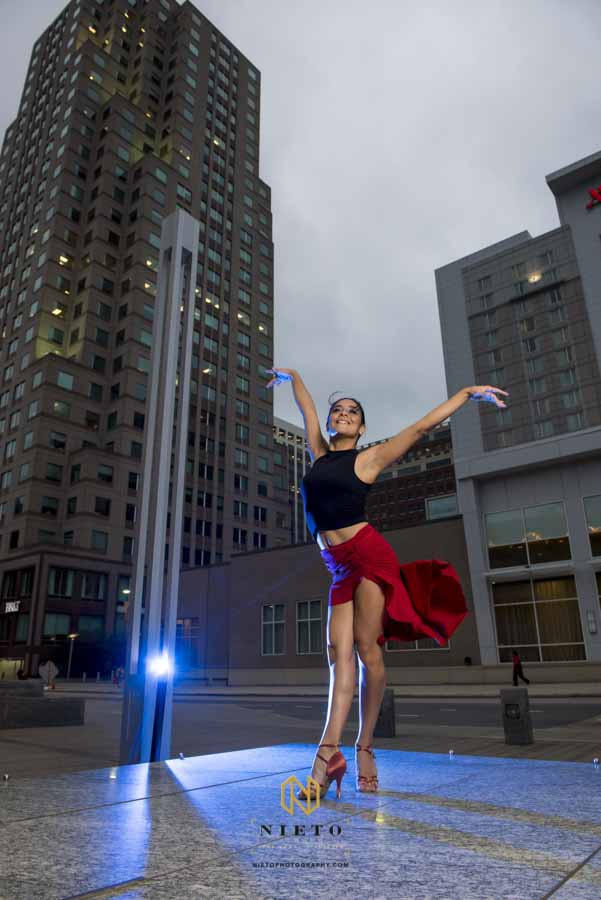 salsa dancer posing in downtown raleigh for a dance portrait