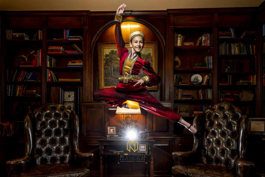 a Russian dancer leaping in the air posing for a dance portrait