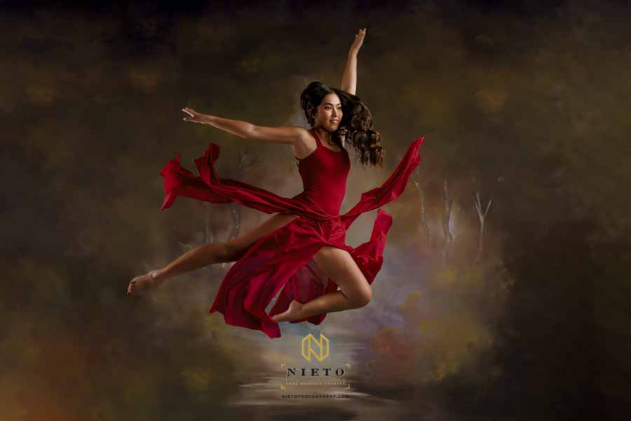 dancer in a red dress jumping in the air