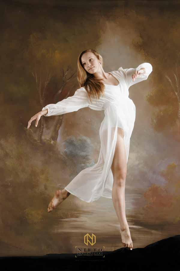 dancer in mid air wearing white
