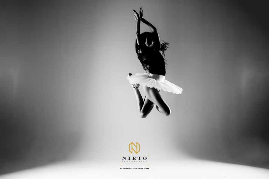 black and white dance portrait of a dancer in mid-air