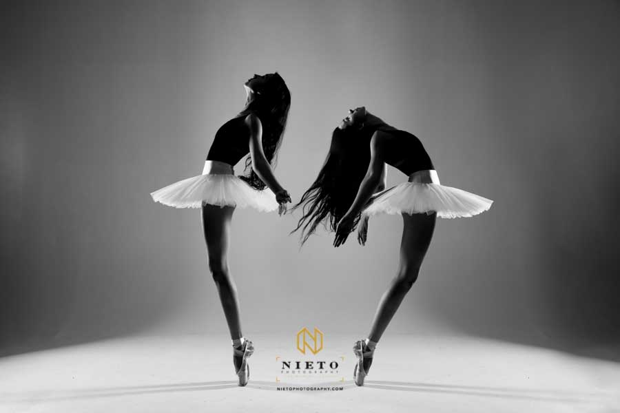 black and white picture of two dancers posing for a Dance Portrait