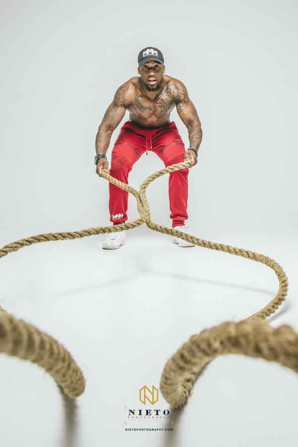Man on the battle ropes posing for a raleigh fitness portrait