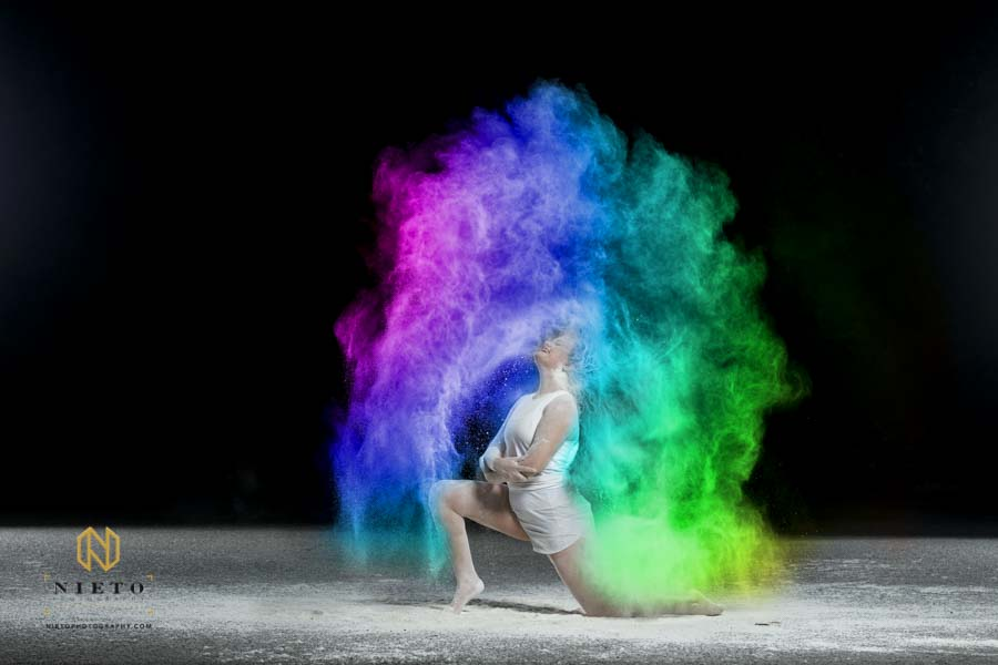 dancer throwing her hair back making a rainbow arch of color