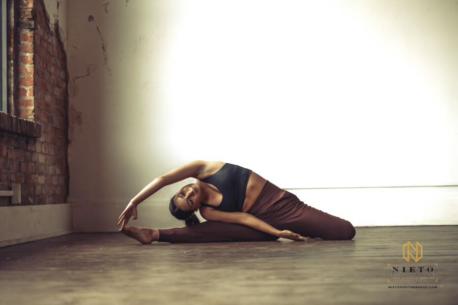 dancer leaning to touch her toes