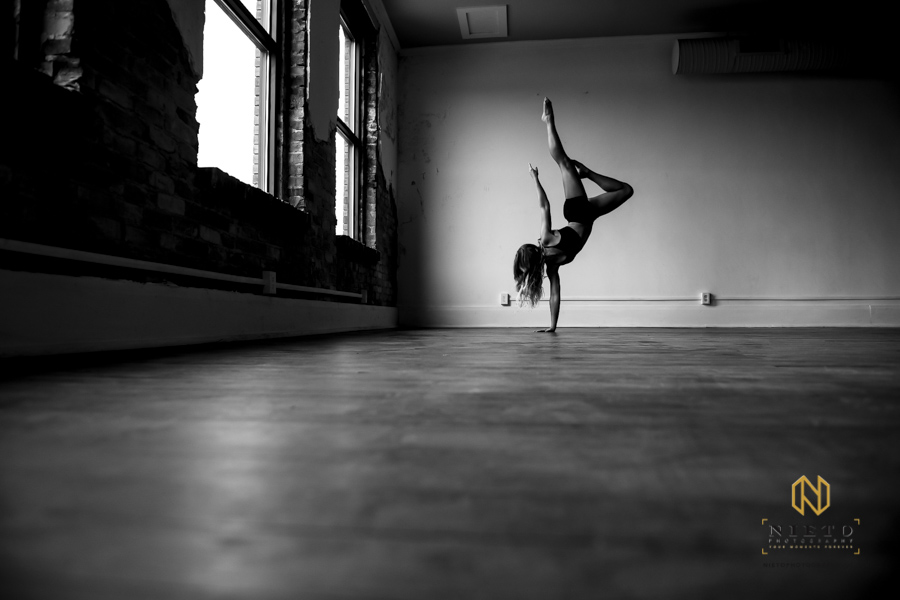 warming up for a dance shoot in a black and white image