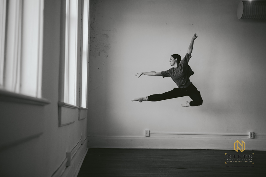 black and white image of a dancer jumping in the air