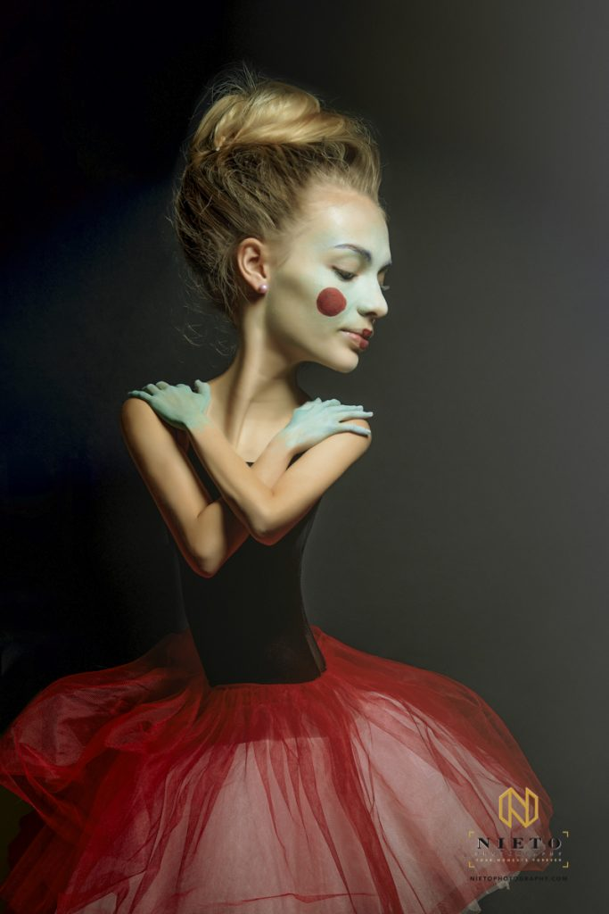 caricature portrait of a ballerina in a red tutu with clown makeup on