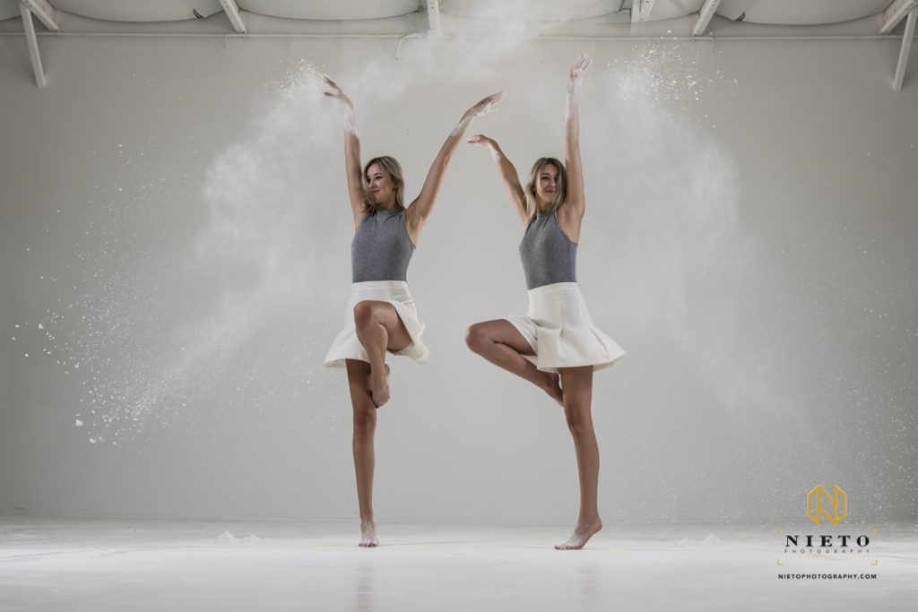 double exposure of a dancer throwing flour in the air in a white room
