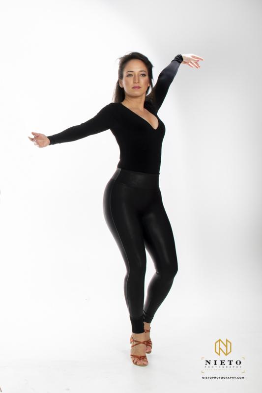 dancer in black on a white backdrop