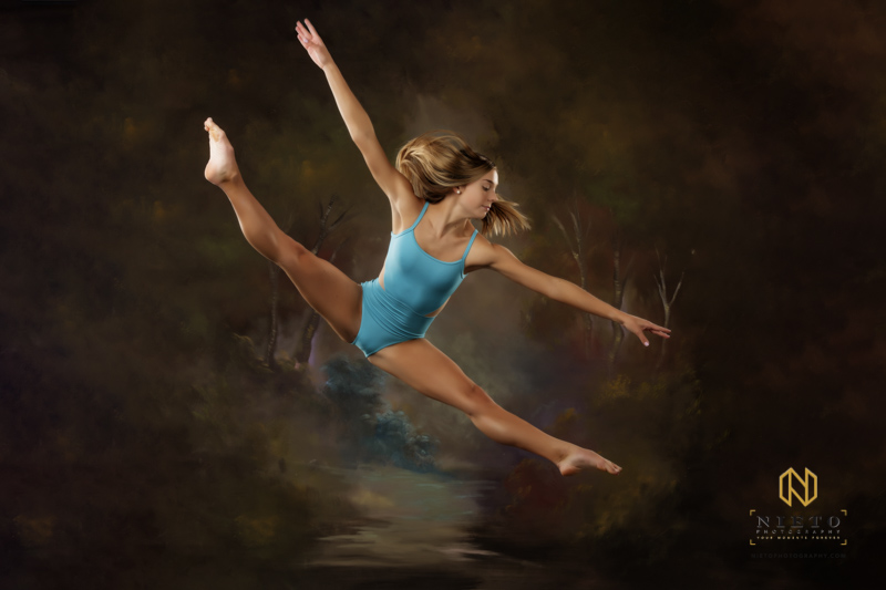 dancer doing a split in the air
