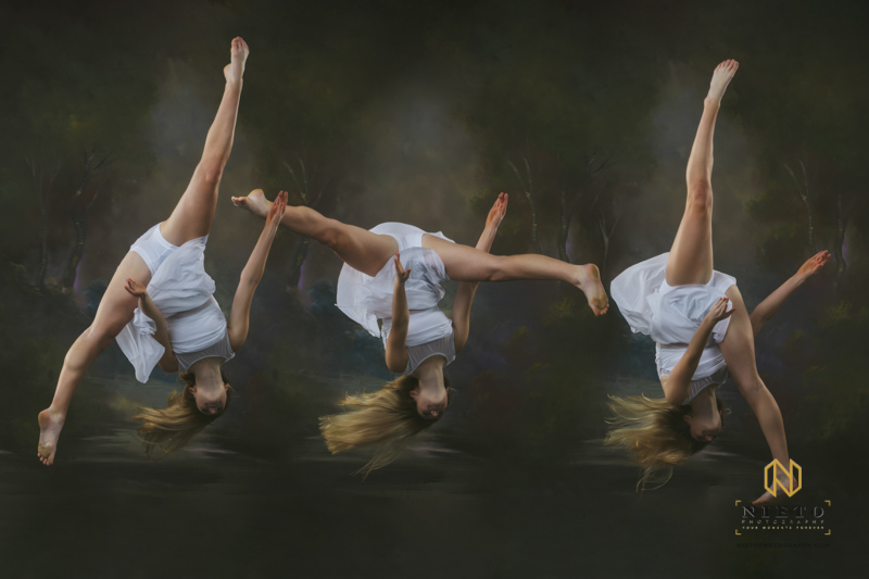 dancer flipping up side down in a white dress